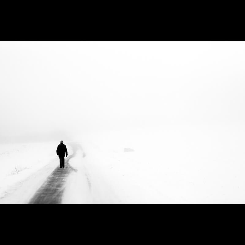 black and white man in the snow