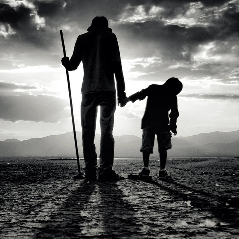 black and white father and kid