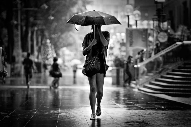 person with umbrella rain