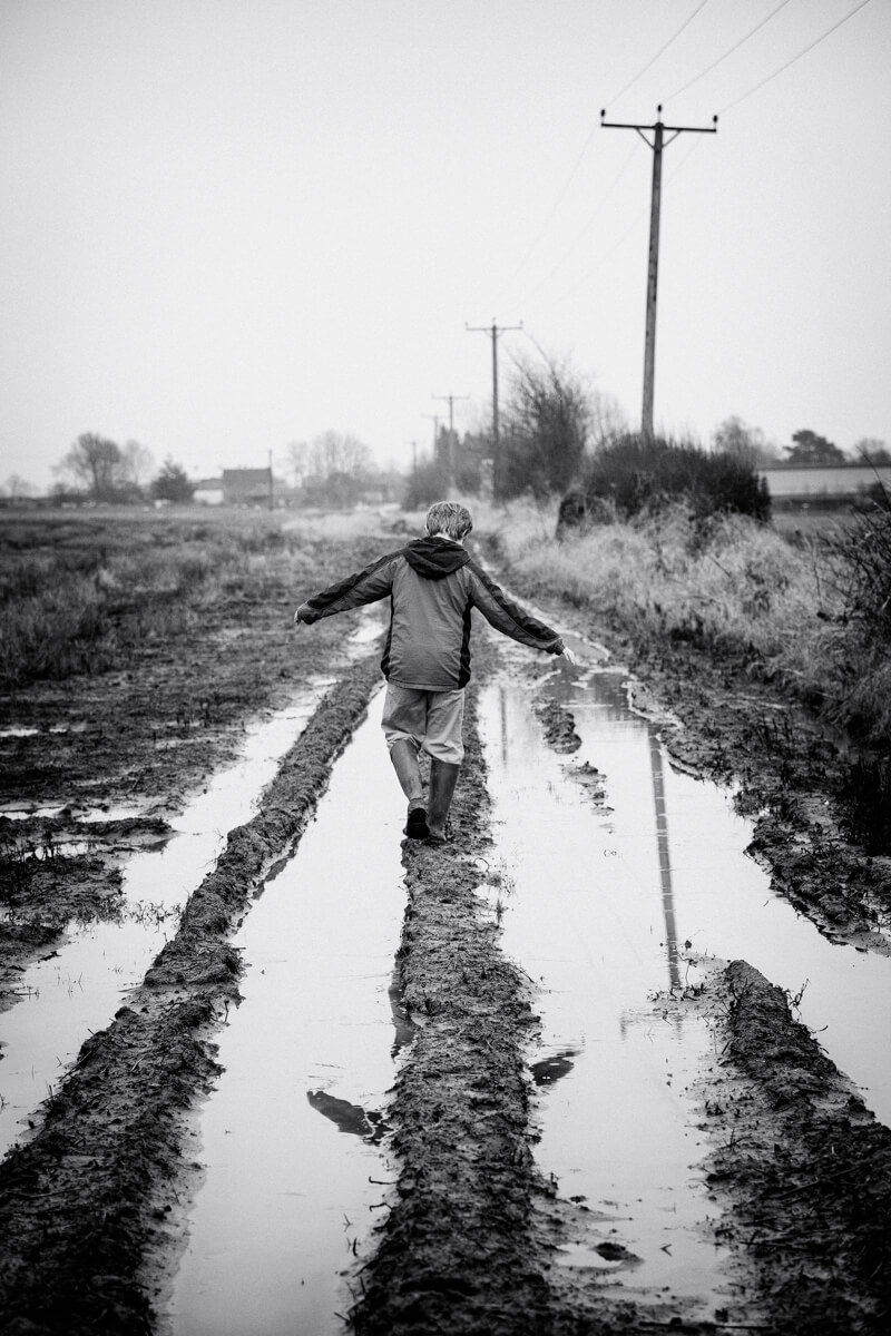boy playing in puddles
