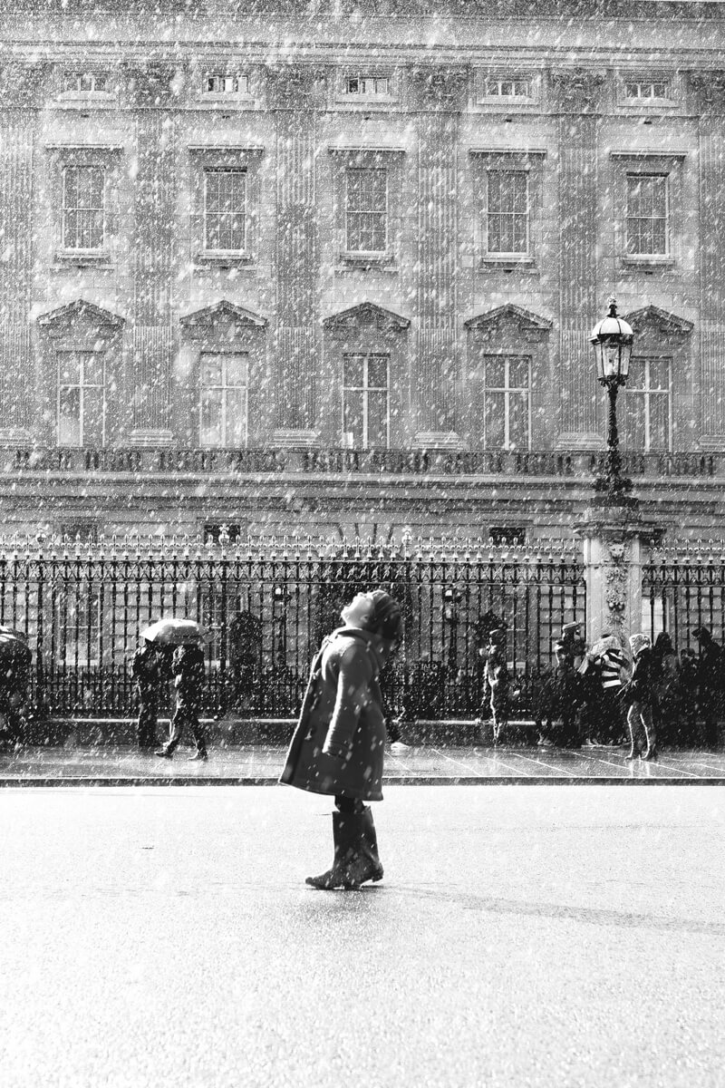 kid standing in the rain