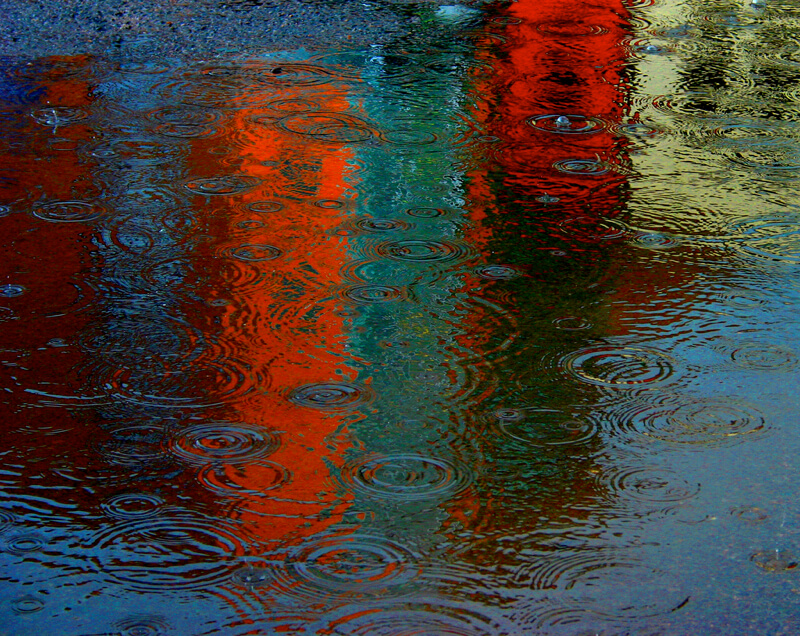 lights reflected in a puddle