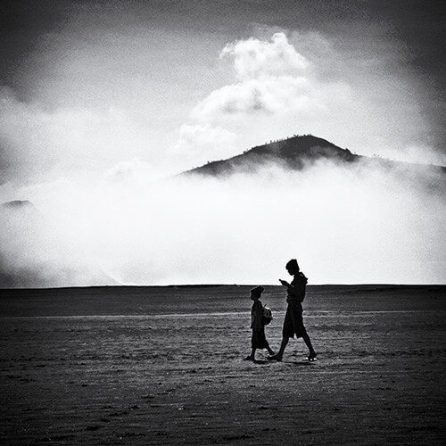 2-boys-walking-on-the-plains-of-Mt-Bromo
