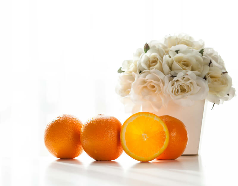 still life photography flowers and oranges