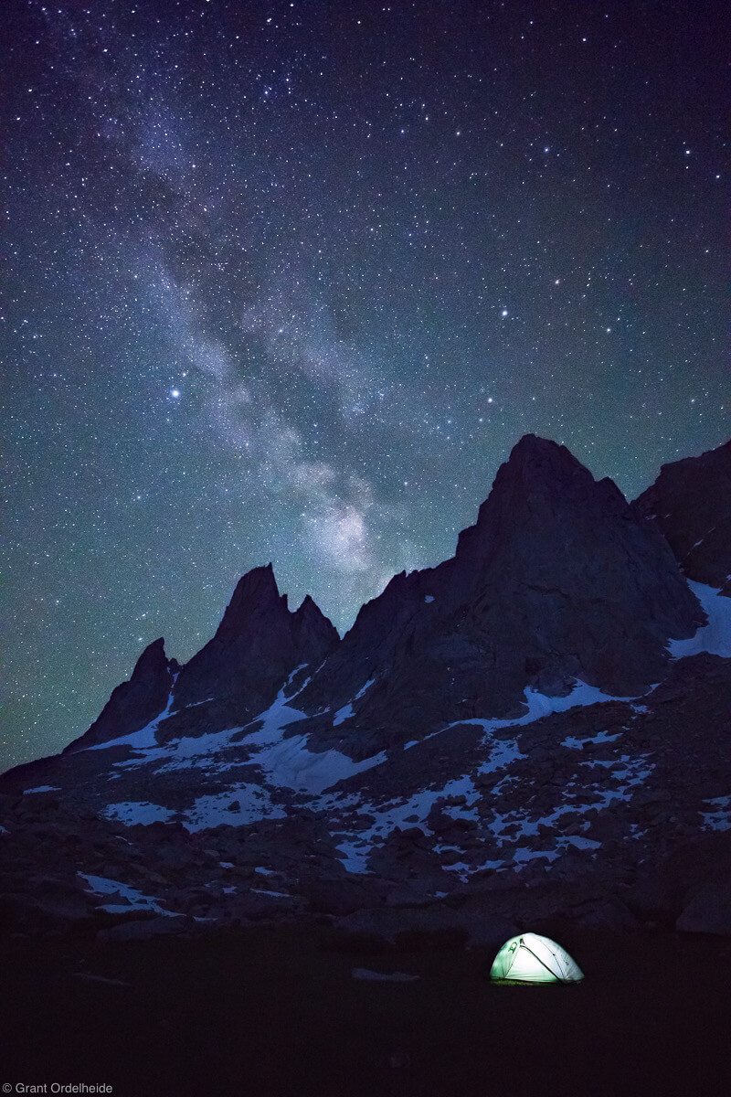 An illuminated tent in Wyoming's Cirque of the towers in the Wind River range.