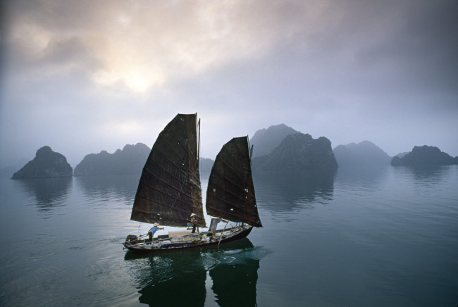 Catherine says travel photojournalism can only be learned by shooting on location: Traditional fishing junks in Halong Bay have become a rarity.