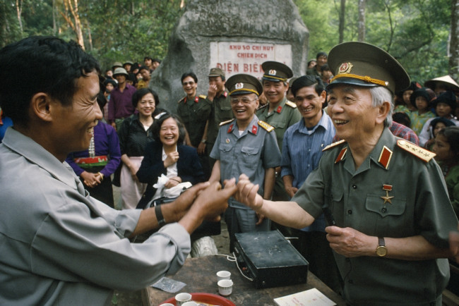 General Giap greets villagers after 40 years, in the forest near Điện Biên Phủ