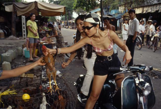 Overseas Vietnamese (Viet Kieu) return, bringing American style to Vietnam. 1994.