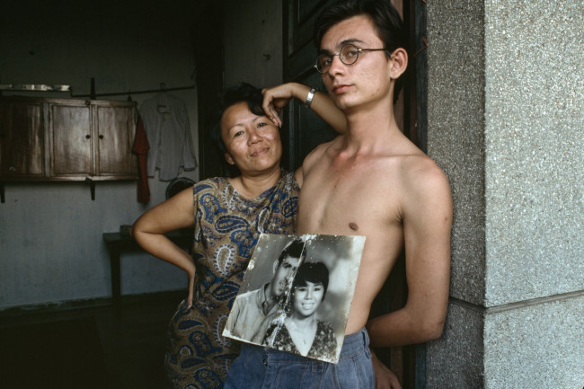 Amerasian boy with his Vietnamese mother; his US soldier father abandoned the family