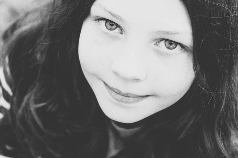 Greig Reid - Daughter Oct 12 faded black & white portrait