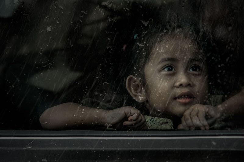 child by window