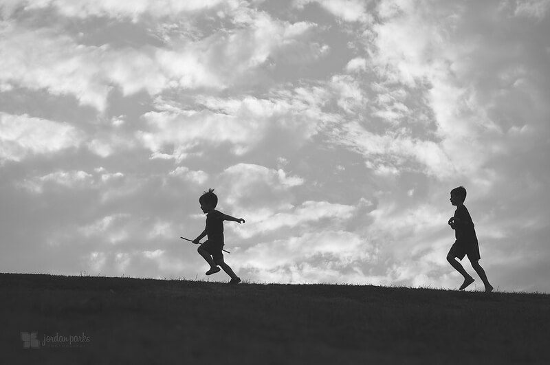 boys running black and white