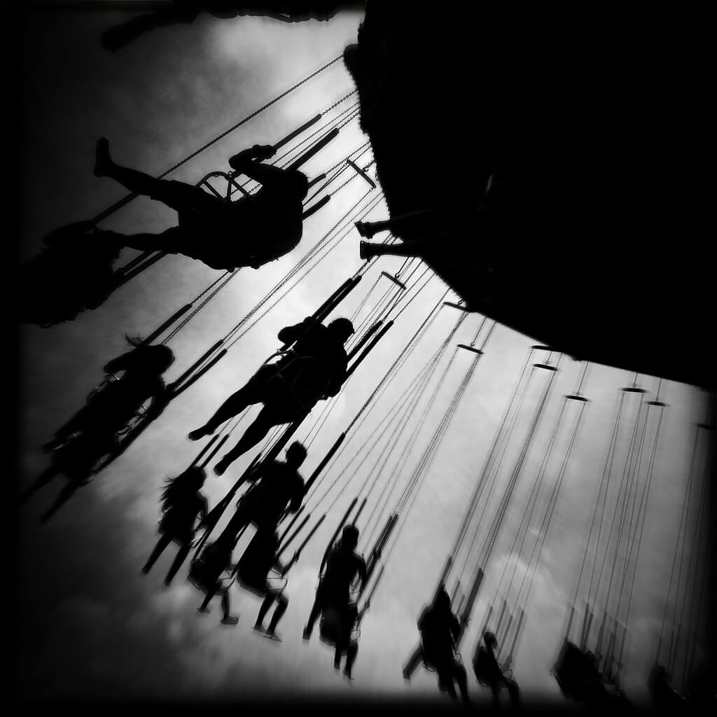 People riding on swing