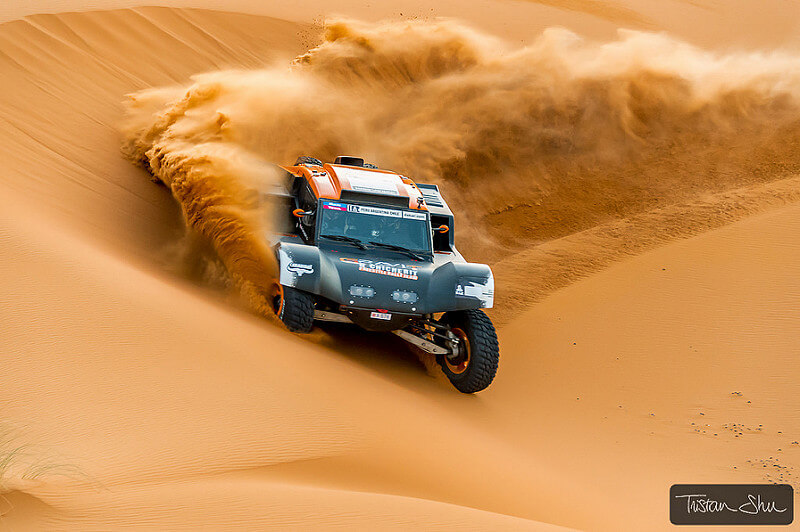 car racing through the Merzuga desert
