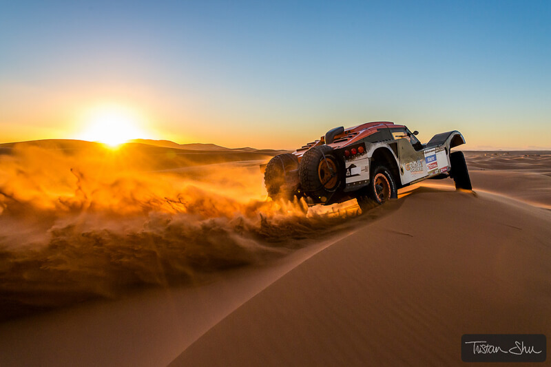 rally car racing through the Merzuga desert