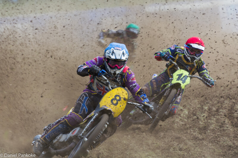 three motocross racers