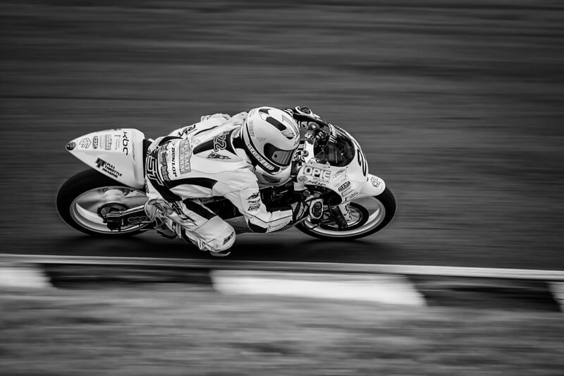motorbike racer going low through a corner