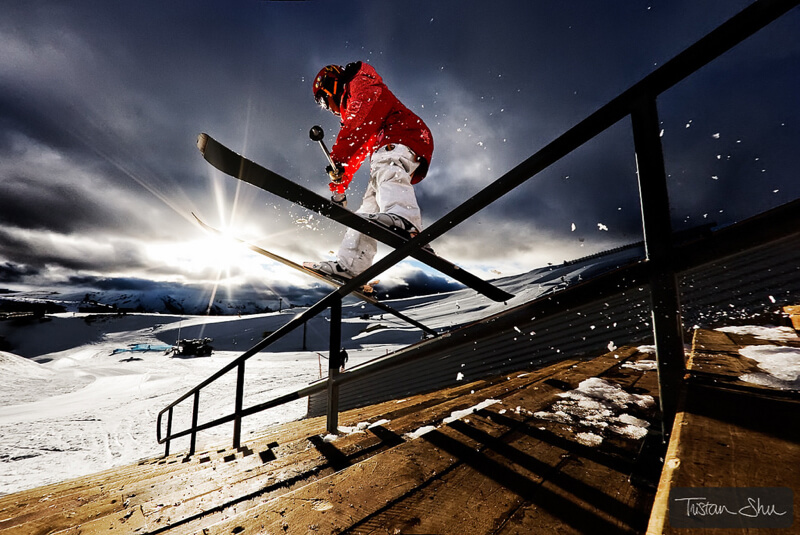Skier grinding down staircase in SnowParkNZ, New Zealand