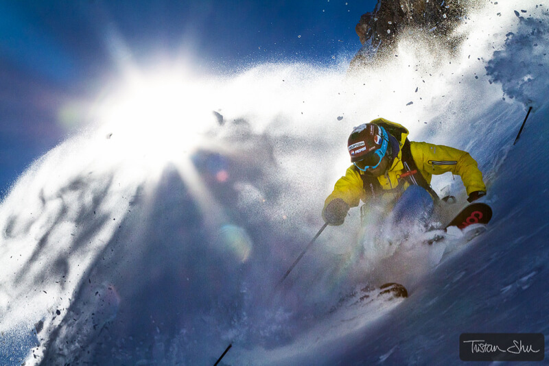 Skier making a turn with snow spraying
