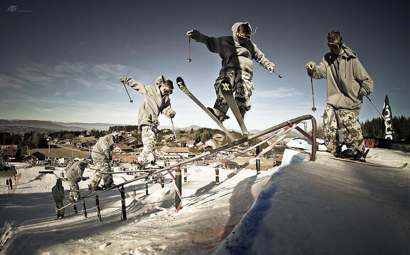 Skier grinding rail
