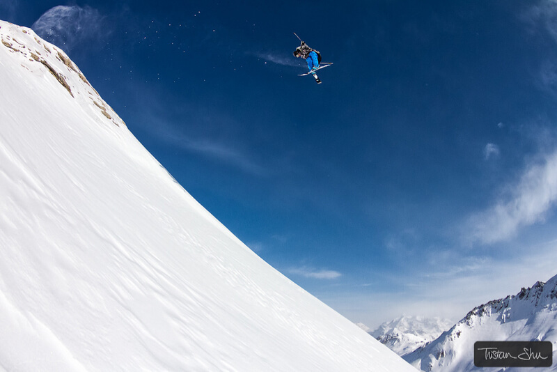 Skier doing a 360 tail grab