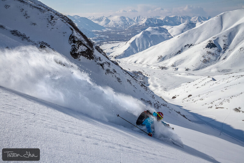 Skier going down a slope in   Kamchatka, Russia