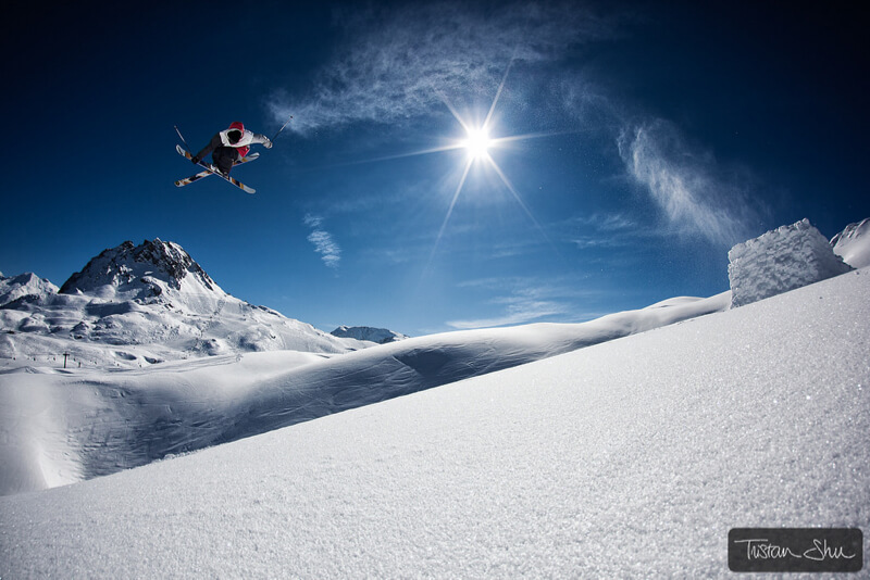 Skier jumping off a backcountry kicker