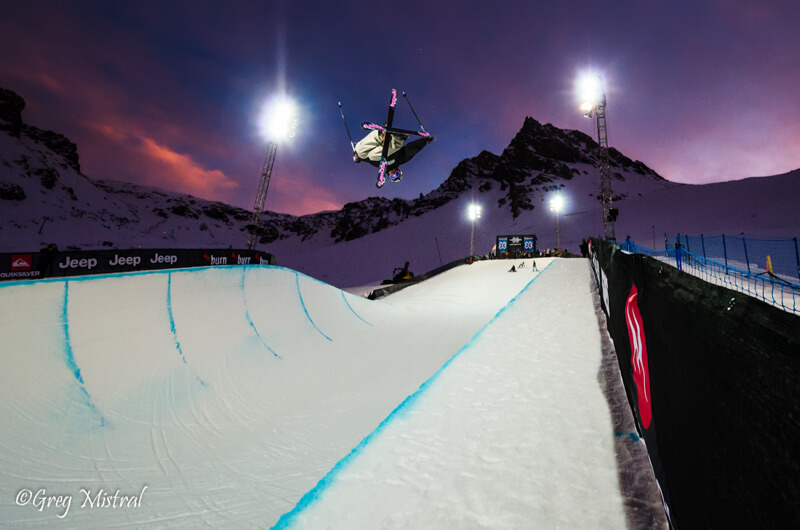 Skier in the half-pipe at sunset