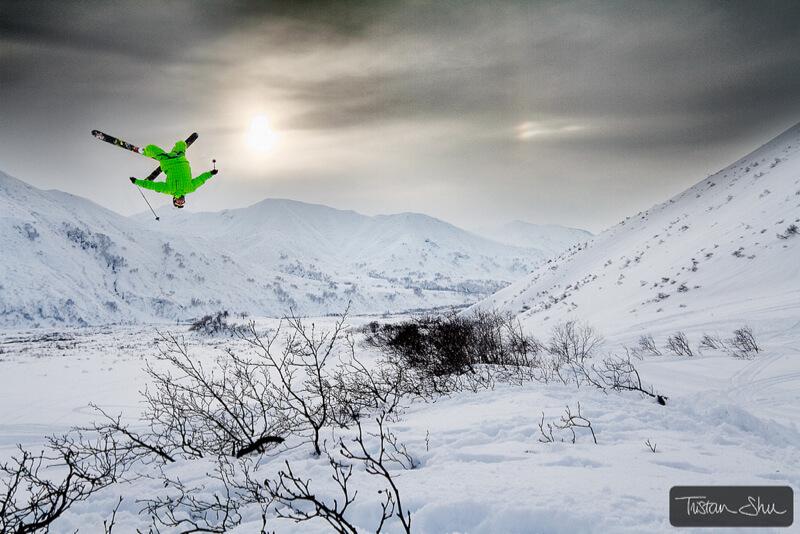 Skier doing a backfilp