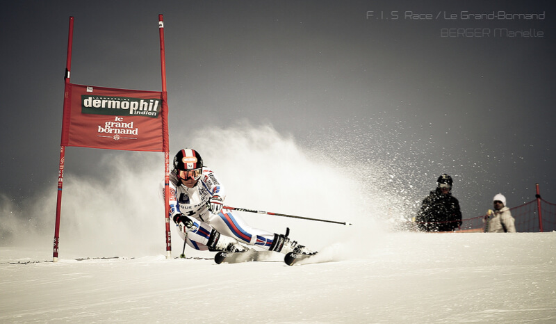Competitive skier going down a slope