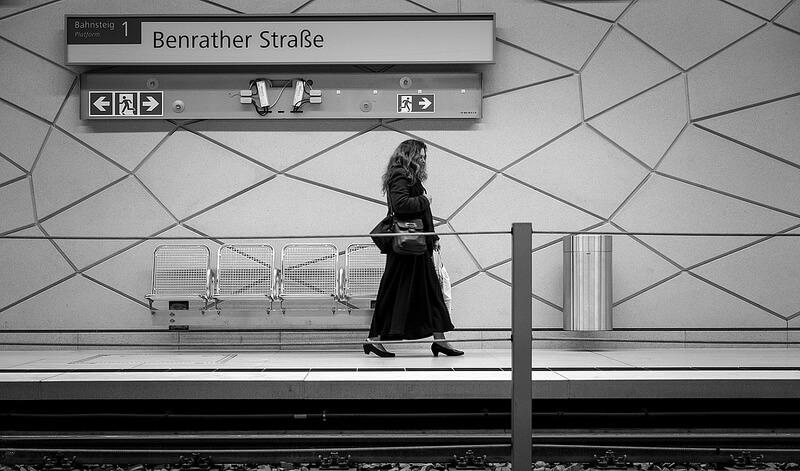 Woman walking in a metro station