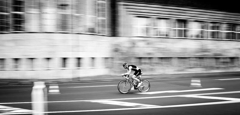 Cyclist going very fast through the city