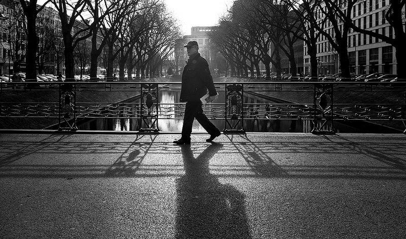 Man walking through Königsallee Düsseldorf