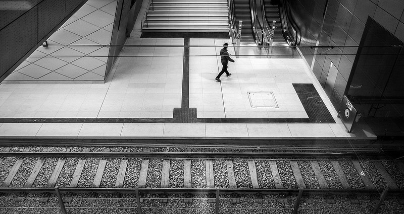 a man photographed through a window at a subway station in Düsseldorf