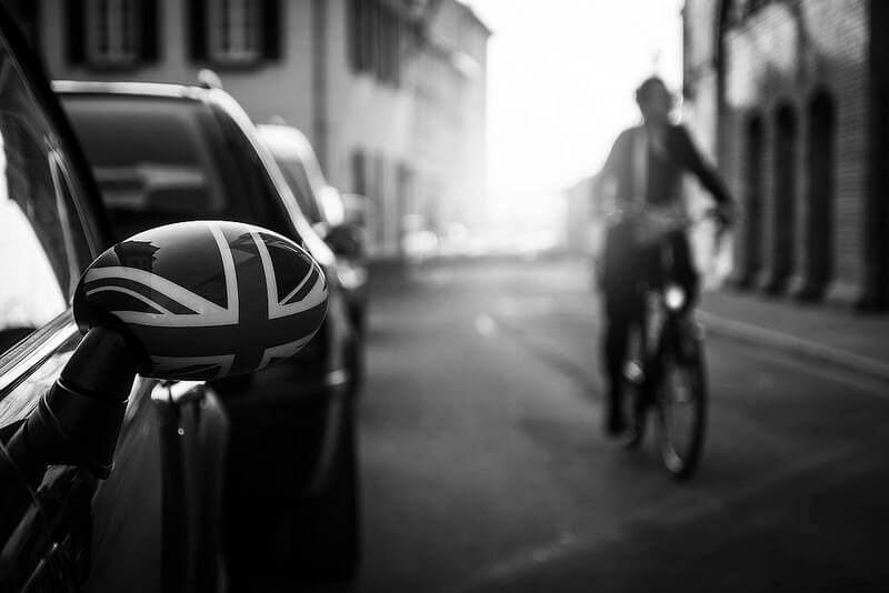 car mirror with union jack and man on a bicycle