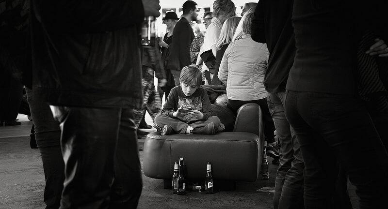 boy sitting on a suitcase