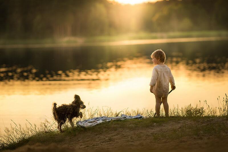 boy dog by lake