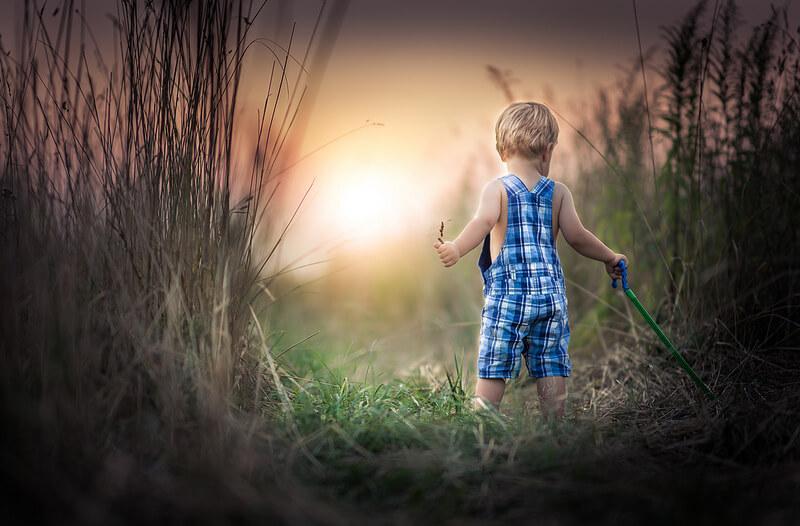 boy tall grass