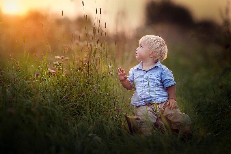 boy in high grass
