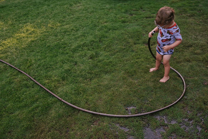 Chrystal Cienfuegos playing with hose