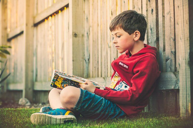 Greig Reid Son reading Batman comic