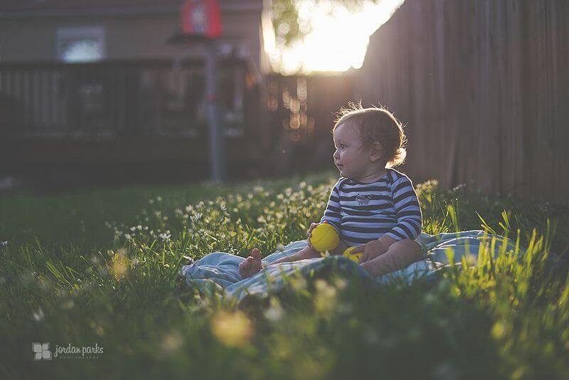 jordan parks baby on grass