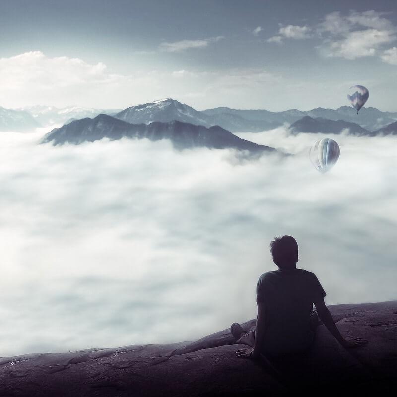 Azfar Nasirudin hot air balloons above clouds