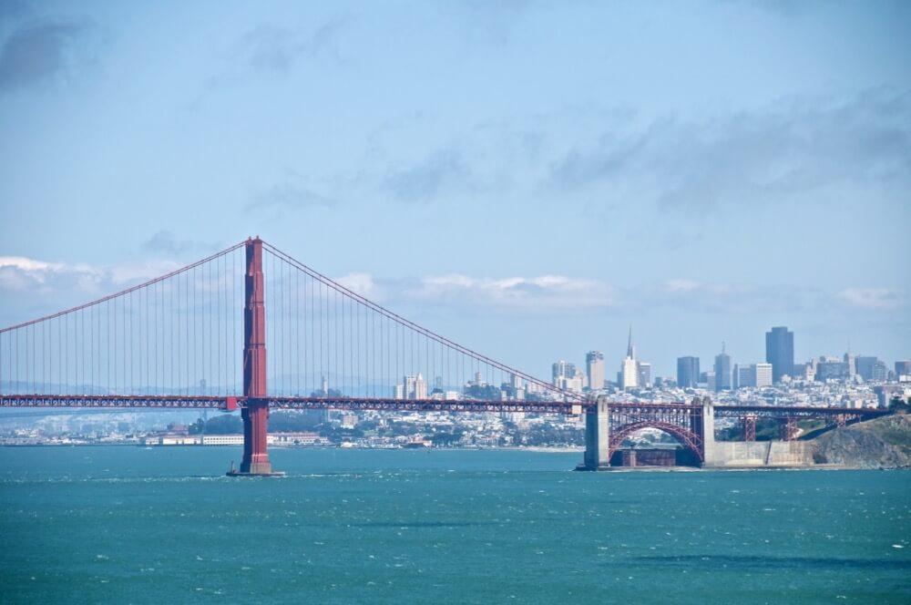 Don DeBold - Golden Gate Bridge and downtown San Francisco as seen from Point Bonita