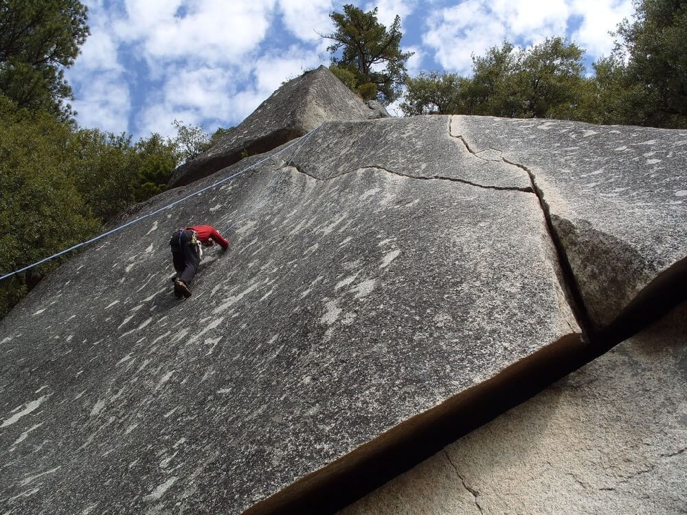 Ryan Grimm - Working hard to stay on an unnamed 5.9 friction climb