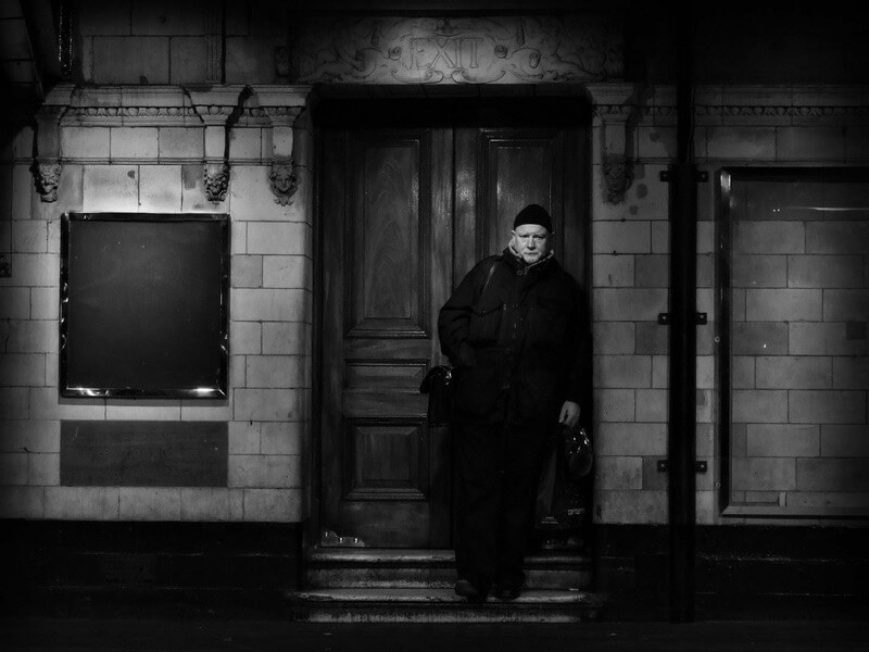 man in door frame