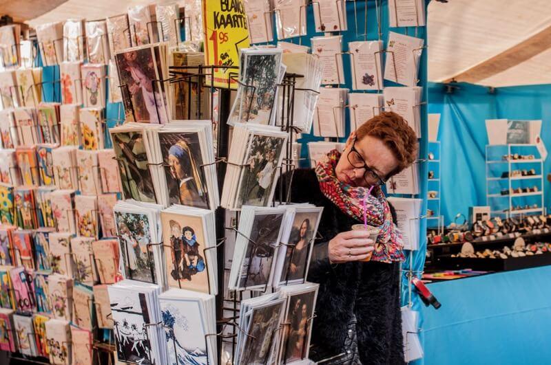 woman choosing a card