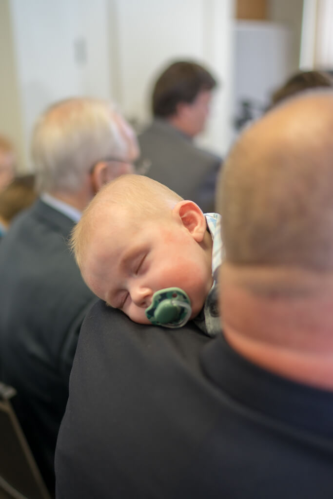 sleeping baby at wedding