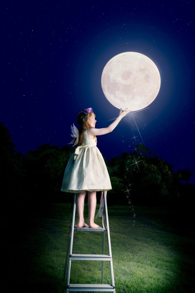 girl touching moon