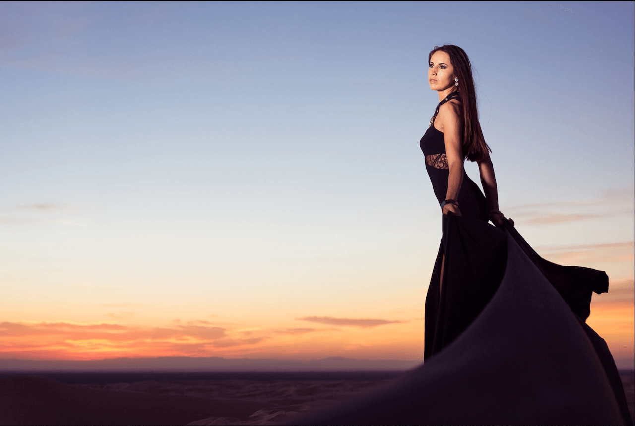 woman stands above horizon